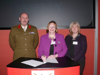 Armed forces representatives from the Royal Military Academy Sandhurst and Deepcut Station with former CEO of Surrey Heath