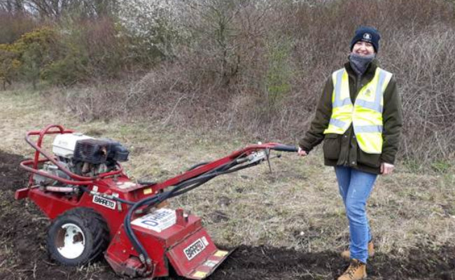 One of our greenspace rangers sowing wildflower verges